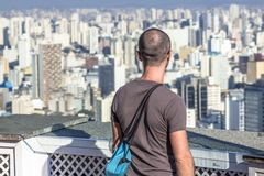 Traveler looking on a big city, travel and active lifestyle concept. São Paulo, Brazil, May 03, 2013. Traveler looking on a big city, travel and active stock image