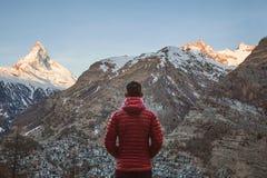 Traveler looking at mountain