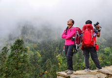 Traveler looking at mountains stock image