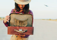Traveler looking for something in the suitcase Royalty Free Stock Photography