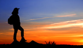 Traveler. Is looking at the sunset Stock Images