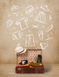 Traveler luggage with hand drawn clothes and icons. On grungy background Royalty Free Stock Photography