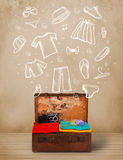 Traveler luggage with hand drawn clothes and icons Royalty Free Stock Photos