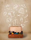 Traveler luggage with hand drawn clothes and icons Royalty Free Stock Images