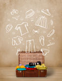 Traveler luggage with hand drawn clothes and icons Royalty Free Stock Image