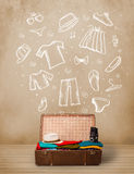 Traveler luggage with hand drawn clothes and icons Stock Photography