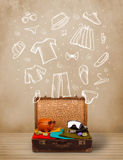 Traveler luggage with hand drawn clothes and icons Royalty Free Stock Photography