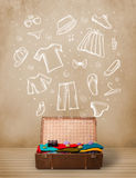 Traveler luggage with hand drawn clothes and icons Stock Photos