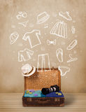 Traveler luggage with hand drawn clothes and icons Stock Images