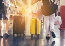 Traveler with luggage on moving walkway at train station.Travel Royalty Free Stock Photos