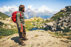 Traveler Man with backpack hiking. Travel Lifestyle concept mountains landscape on background adventure vacations outdoor stock images