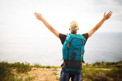 Traveler man with backpack landscape on background. Travel, happy, summer, vacations concept. Traveler men with backpack landscape on background. Travel happy stock images