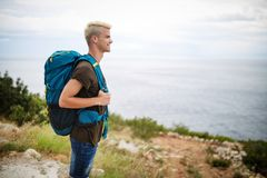Traveler man with backpack landscape on background. Travel, happy, summer, vacations concept. Traveler men with backpack landscape on background. Travel happy royalty free stock photos