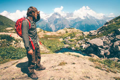 Traveler Man with backpack looking at mountains. Travel Lifestyle concept serene view landscape on background adventure vacations outdoor royalty free stock image
