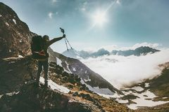Traveler Man with backpack on mountain summit. Travel success lifestyle survival concept adventure outdoor active vacations climbing sport gear wild nature Stock Photography