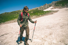 Traveler Man with backpack mountaineering glacier Stock Photo