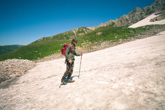 Traveler Man with backpack mountaineering glacier Royalty Free Stock Photography