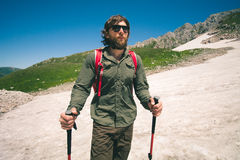 Traveler Man with backpack mountaineering glacier Stock Images