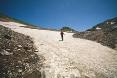 Traveler Man with backpack mountaineering glacier Stock Image