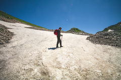 Traveler Man with backpack mountaineering glacier Royalty Free Stock Images