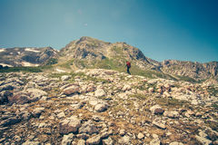 Traveler Man with backpack mountaineering outdoor Royalty Free Stock Photo