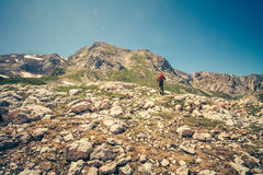 Traveler Man with backpack mountaineering outdoor Stock Photo