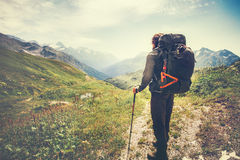 Traveler Man with backpack mountaineering. Travel Lifestyle concept mountains and clouds on background Summer adventure vacations outdoor stock photo