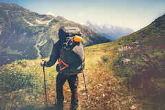 Traveler Man with backpack mountaineering. Travel Lifestyle concept rocky mountains on background adventure vacations outdoor royalty free stock photo