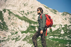 Traveler Man bearded with backpack mountaineering Royalty Free Stock Photography