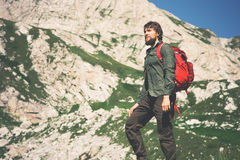 Traveler Man bearded with backpack mountaineering Royalty Free Stock Photos