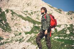 Traveler Man bearded with backpack mountaineering Stock Photo