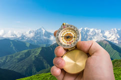 Traveler man with compass seeking a right way in the mountains Stock Photography