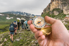 Traveler man with compass seeking a right way in the mountains Royalty Free Stock Photo