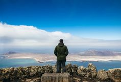 Free Traveler Man Enjoying Beautiful Seascape At Viewpoint On Island Stock Photography - 128239922