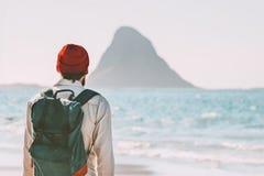 Traveler man enjoying Bleiksoya view walking alone on beach royalty free stock image