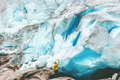 Traveler Man enjoying Nigardsbreen glacier view Royalty Free Stock Photo