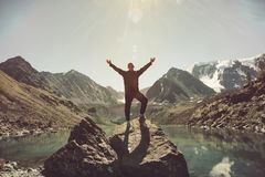 Traveler man happy raised hands on the mountain top in Norway wanderlust traveling explorer healthy lifestyle adventure concept ac royalty free stock photos