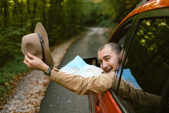 Traveler  man with hat  looking map near car in autumn forest Stock Photography