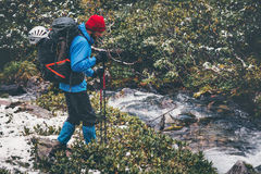 Traveler Man hiking alone in forest Stock Photography