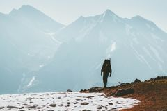 Traveler Man hiking in mountains Lifestyle travel survival concept. Adventure outdoor active vacations climbing sport wild nature royalty free stock photo
