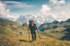 Traveler Man hiking Travel Lifestyle. Concept cloudy mountains landscape on background adventure vacations outdoor royalty free stock photos