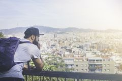 Traveler man looking on a big city, travel and active lifestyle concept.Bearded Tourist Man with backpack enjoy. Beautiful city view royalty free stock images