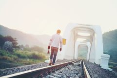 Traveler man  railway vintage tone and soft focus Royalty Free Stock Image