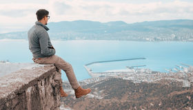 Traveler man sitting over the bay Royalty Free Stock Photography