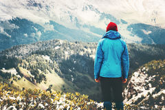 Traveler Man standing alone on mountain cliff Stock Images