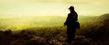 Traveler man standing with dramatic nature Stock Photography