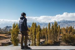 Traveler Man standing and looking view of landscape in Leh Ladakh District ,Norther part of India