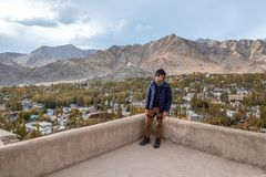 Traveler Man standing and looking view of landscape in Leh Palace ,Norther part of India