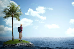 Traveler man standing on the small island on the sea Royalty Free Stock Photo