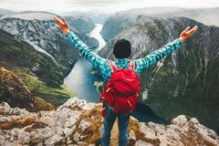 Traveler Man on the top of mountain success raised hands Royalty Free Stock Photography